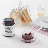 Hawkshead Relish Company Raspberry & Vanilla Jam - Open jar on laid table