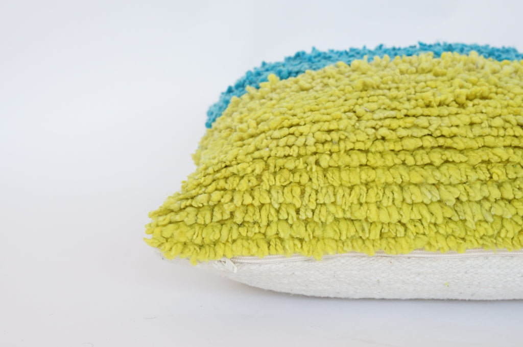 green and turquoise woven wool throw pillow by willful goods