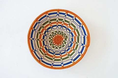 colorful web design woven basket from Senegal willful goods