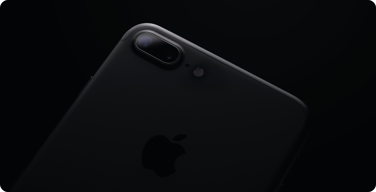 a black iphone over a black background