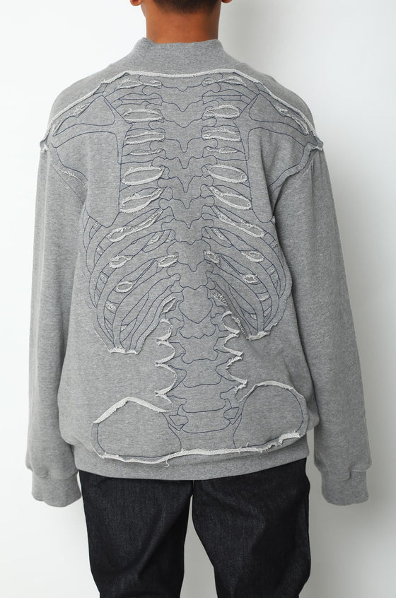 Handcrafted sweatshirt with backbone patchwork
