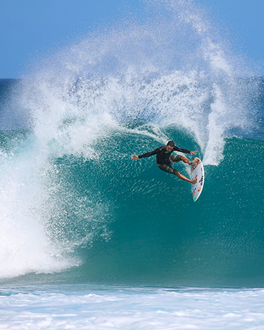surfer performing cutback on wave