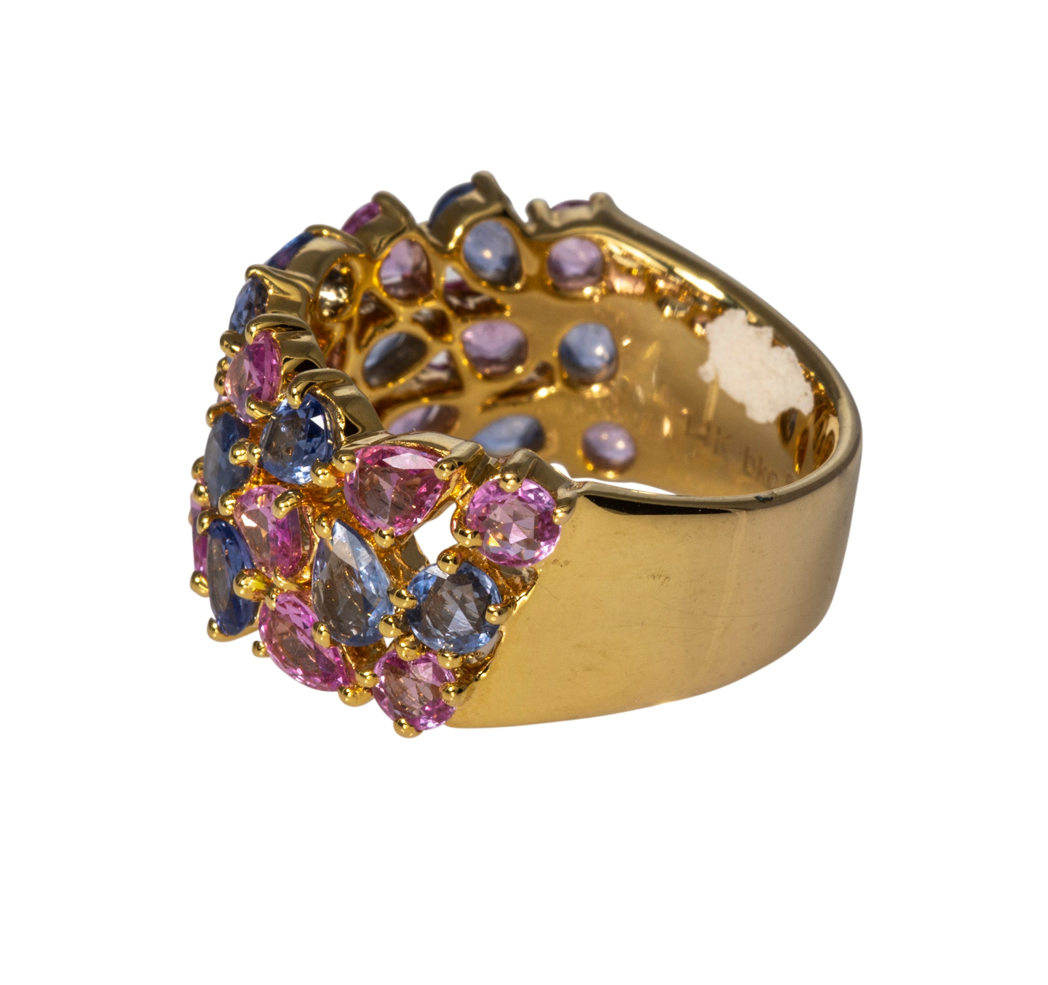 This ring features three rows of multi-colored pink and blue sapphires in various shapes set halfway in 14K yellow gold with a wide, slightly tapered band.  Total sapphire weight: 3.68ct  Ring size: 6
