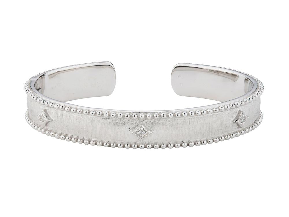 From the JudeFrances Silver Collection, the Silver Narrow Nina Beaded Kite Cuff bangle features round faceted white topaz set in sterling silver kites and the signature brushed JFJ finish and sterling silver beading.  Width: 10mm  Circumference: 6.5""