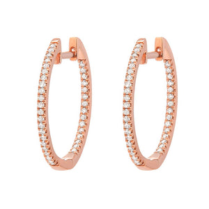 These large huggie hoop earrings in 14K rose gold are strikingly set with micro-pave diamonds in an in and out formation for maximum sparkle.