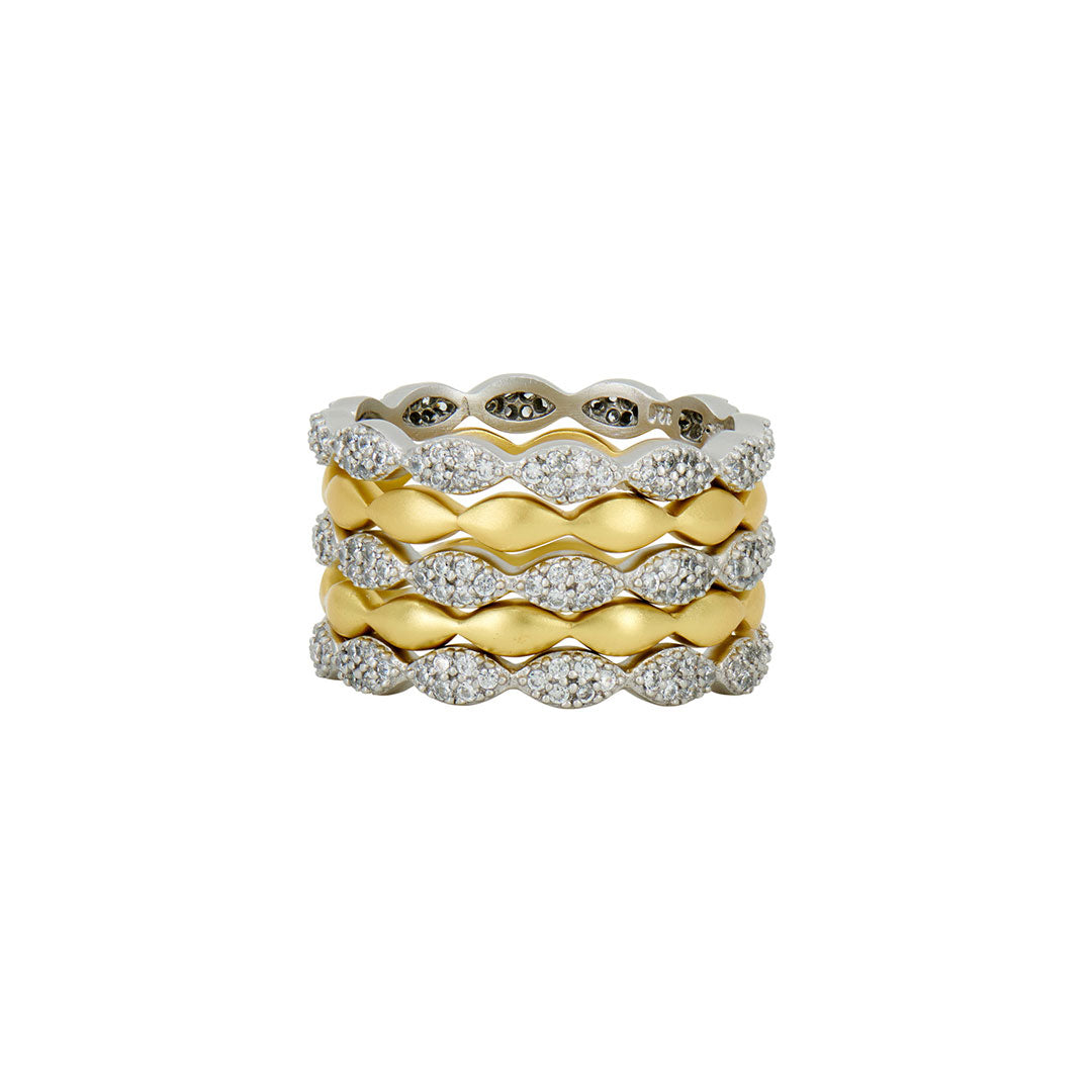 Freida Rothman Layers of Armor 5-Stack Ring features sparkling pavé stones alternating with matte yellow gold bands.