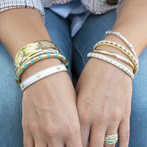 From the JudeFrances Mixed Metal Collection, the Mixed Metal Narrow Nina Beaded Kite Cuff features sterling silver and 18K yellow gold with prong-set round diamonds and the signature brushed JFJ finish and sterling silver beading.