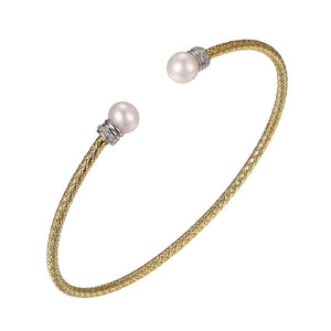 Charles Garnier Sterling silver flexible mesh cuff bangle bracelet featuring freshwater pearls, cubic zirconia stone accents, 18K yellow gold finish, and rhodium finish.  Width: 2mm  Circumference: 6.75""