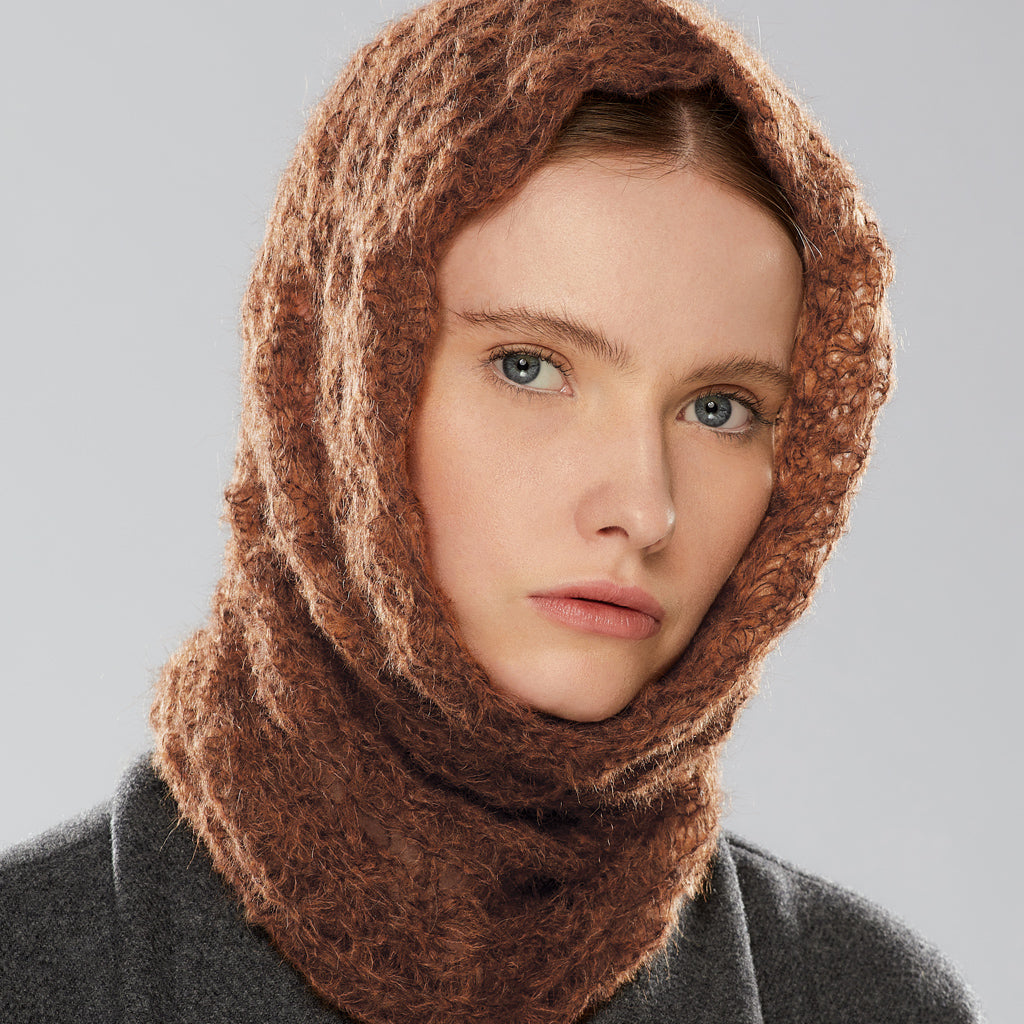 Web Loop Scarf worn as a hood