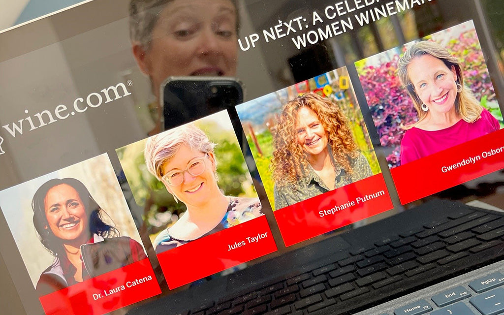 Jules Taylor reflected in computer screen showing speakers in wine.com women winemakers virtual tasting