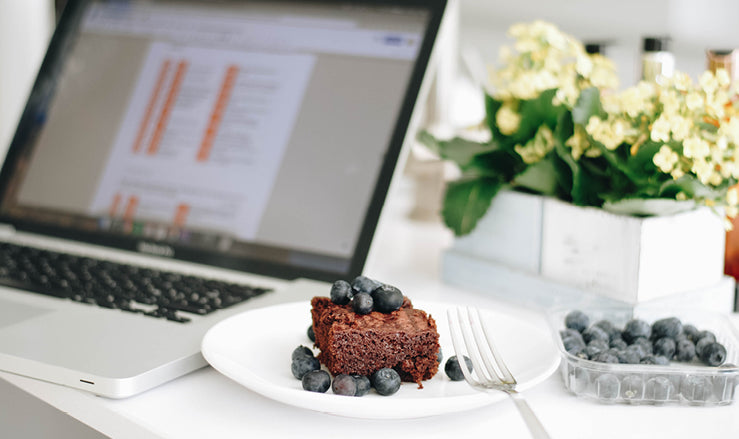Paleo brownie and blueberries on plate