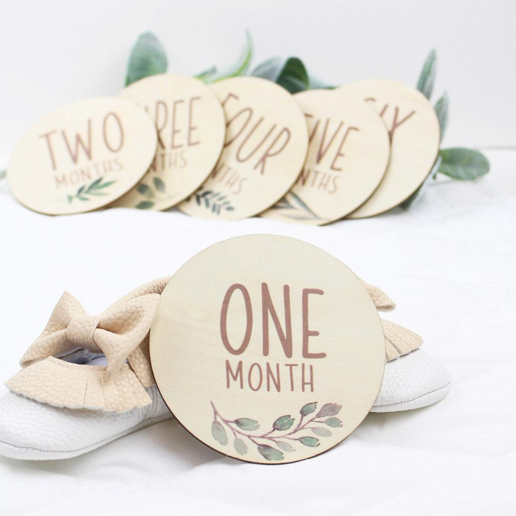 Six double-sided milestone discs from one-month to twelve-months from Birchmark Designs