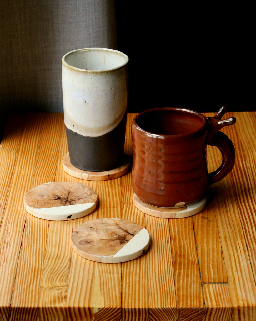 wood coasters with two ceramic mugs