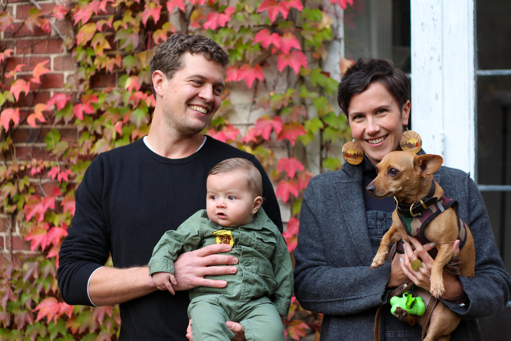woman, man, baby and small dog outdoors