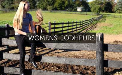 A young woman in a barn with an American Saddlebread wearing Hot Jods brand Jodhpurs
