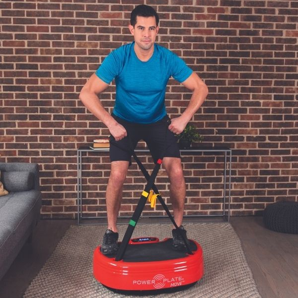 Power Plate Move Vibration Trainer - Man on Power Plate Move with dual straps doing an exercise