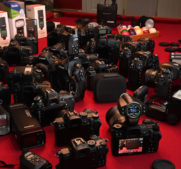 An image of a large number of cameras on a table with the FusionTLC Raven.