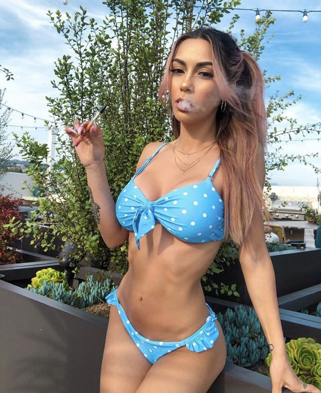 GLASS BONGS FOR SALE... girl puffing a blunt enjoy the sun- ALWAYS SHOP WITH FULL CONFIDENCE!
