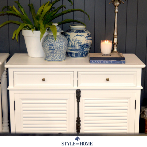 White storage sideboard with louvre doors and brass handle details