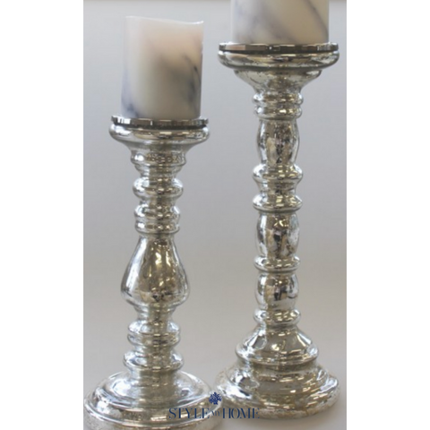 Silver candle holder stick with an antique rustic finish