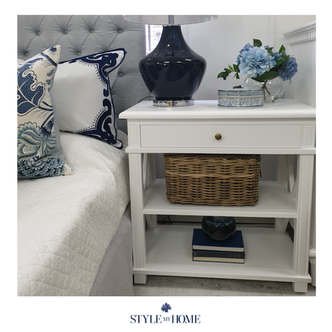 White petite entertainment unit with cross details and one draw with brass handle