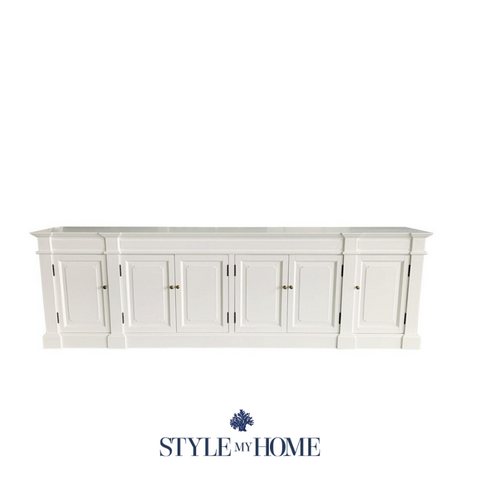 White entertainment unit with detailed doors and brass handles
