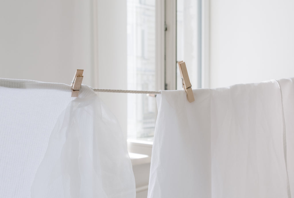 White Textile on Brown Clothes Hanger by cottonbro