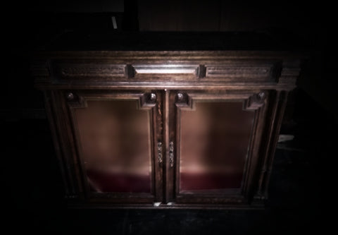 light shining on cabinet in the dark
