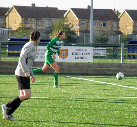 Phoebe playing football for North Ferriby ladies