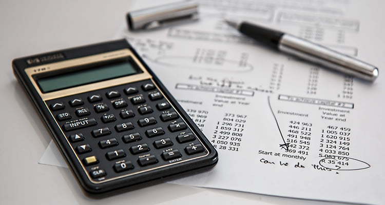 Reviewing accounts with a calculator