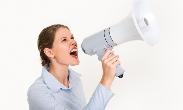 Lady shouting with a megaphone