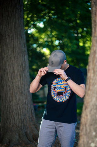 Graphic Tee with Bigfoot Print in blue, yellow, and orange