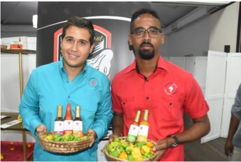 Scotch Boyz principals Drew Gray (left) and Matthew Wallace show off their nominated products (from left) jerk sauce, authentic Jamaican hot pepper sauce, Jamaican fish and meat sauce, habanero pepper sauce and Scotch bonnet pepper sauce.
