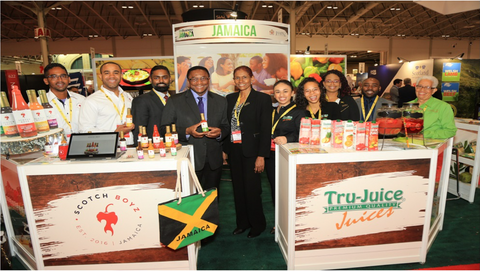 Toronto Deputy Mayor, Chair, Economic and Community Development Committee, and Councillor, Scarborough Centre, Michael Thompson (centre left) takes a photo with the Jamaican delegation including representatives from Scotch Boyz, JAMPRO, Tru Juice, Caribbean Dreams and Linga Ya, at trade exhibition SIAL Canada.