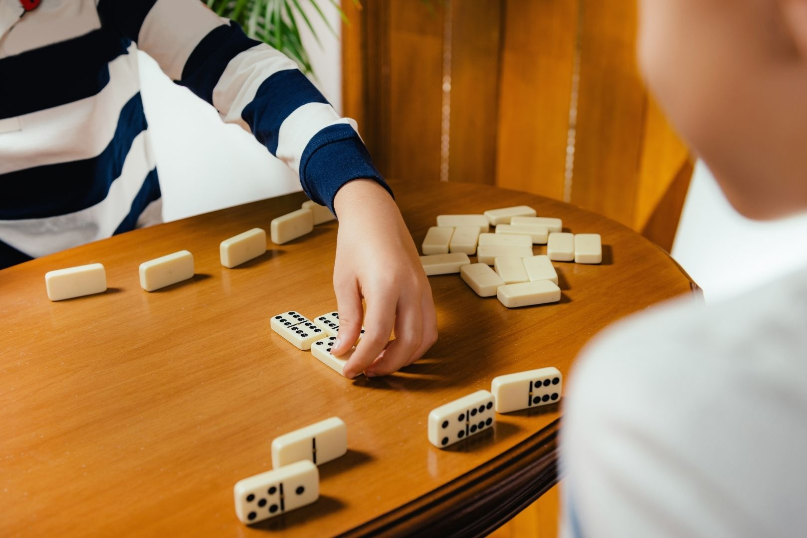 Kids playing with educational toy dominoes