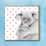 Greeting card with pink heart background, Koala and Baby Koala in centre