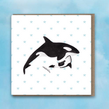 Greeting card with pink heart background, Orca and Baby Orca in centre