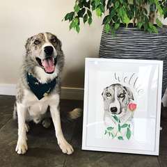Cute dog posing next to A3 pet portrait in white frame