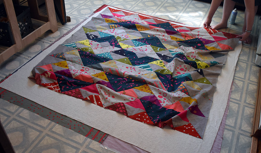 Lay out quilt top
