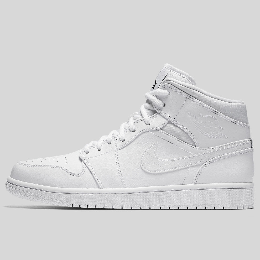 d6058e9e9ea397 Nike Air Jordan 1 Mid Triple White (554724-110)