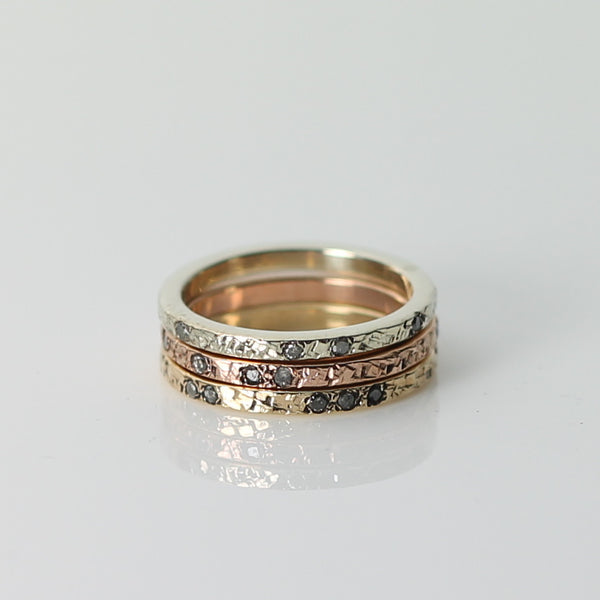 Gold and diamond eternity rings