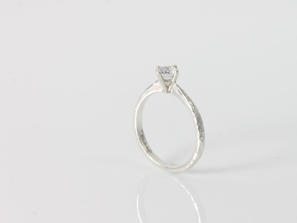 Textured solitaire engagement ring