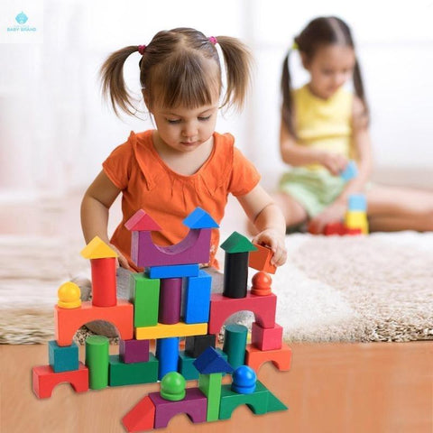 Girl playing with Wooden Block Building Set