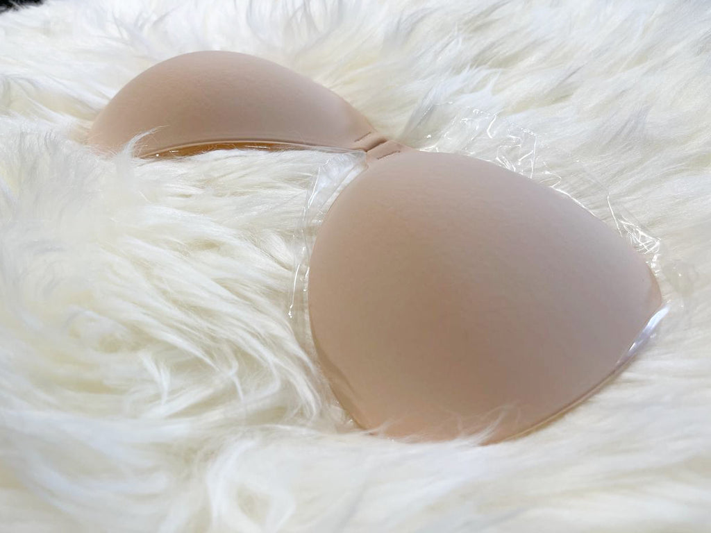 close up of nude bra on white fur