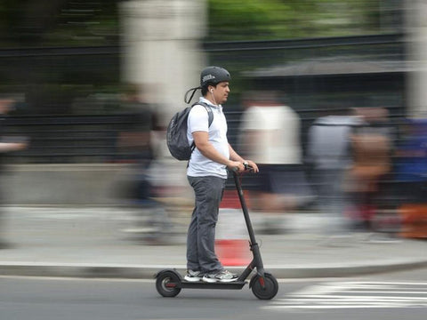 man on E scooter