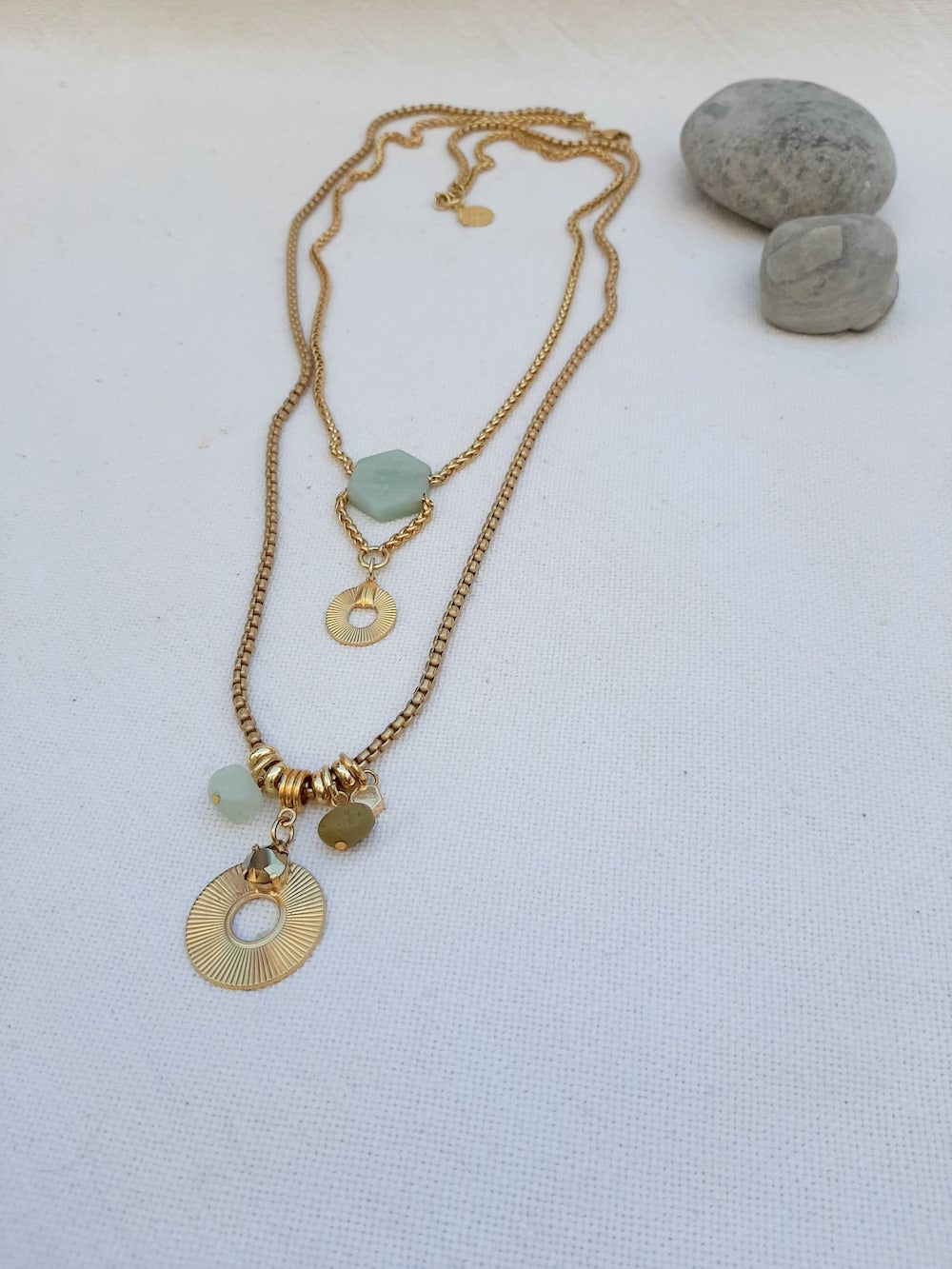 Two layered long gold chain necklace with gold disc & aqua stone drop pendant and charms