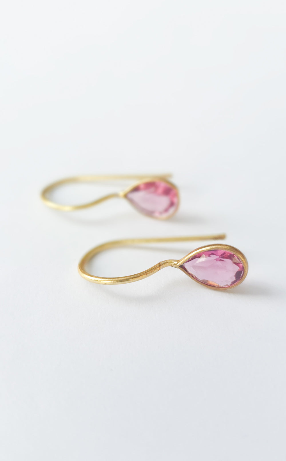 Small gold hook earrings with tear drop pink tourmaline