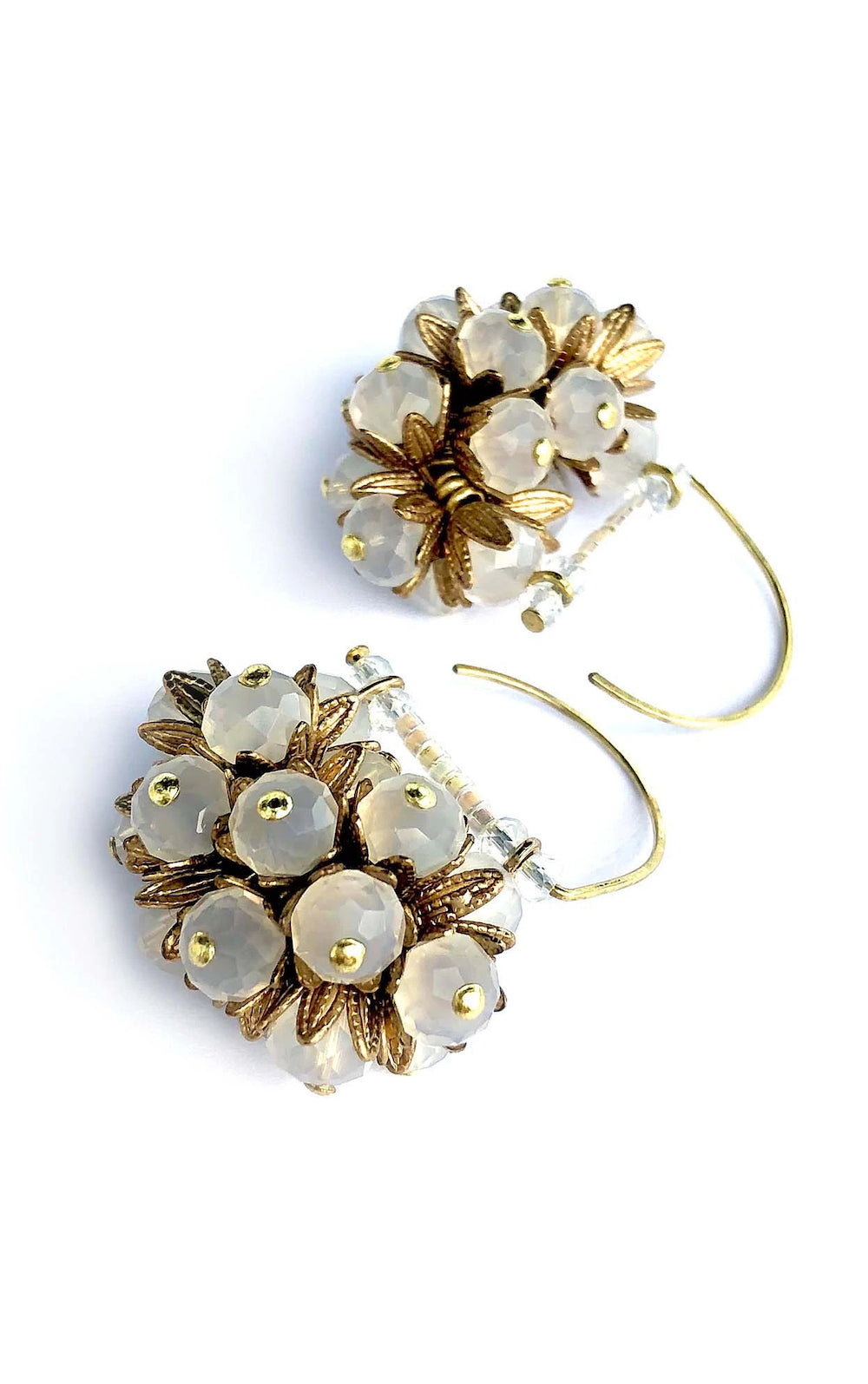 Hook gold earring with cluster of gold leaves and clear crystal beads