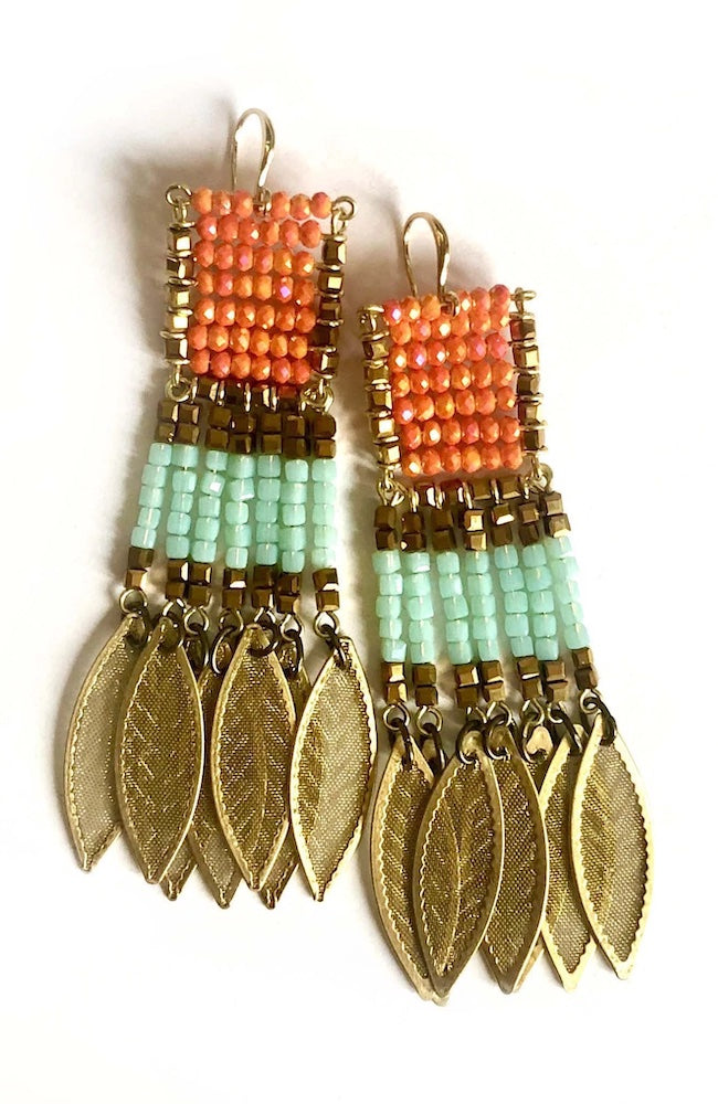 Dangling earring made of gold, orange and green beads in a rectangular arrangement ending in seven gold leaves