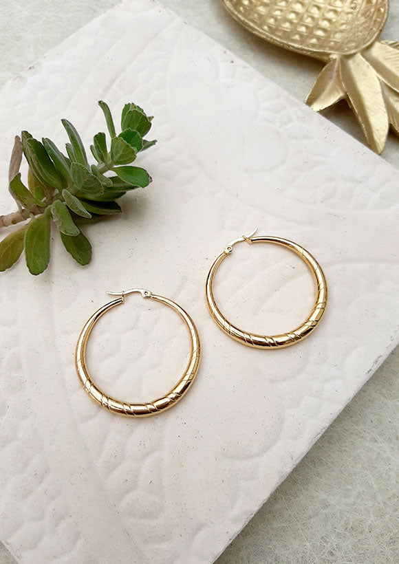 Large gold textured hoop earrings by Shelly Dahari
